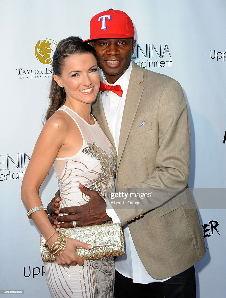 Actress Menina Fortunato and actor/producer Sheldon Robins arrive for the Premiere Of Upper Laventille's'Murder 101' held at Raleigh Studios' Chaplin Theater on June 12, 2014 in Los Angeles, California.