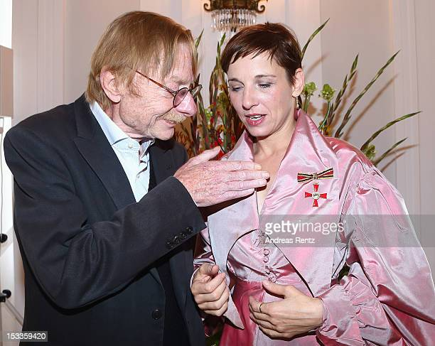 Actress Meret Becker and her father Otto Sander smile at Bellevue Palace on October 4 2012 in Berlin Germany Becker received the Federal Cross of...