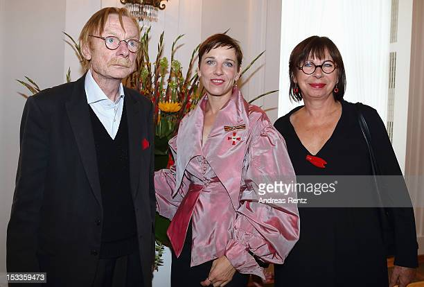 Actress Meret Becker and her father Otto Sander with Monika Hansen smile at Bellevue Palace on October 4 2012 in Berlin Germany Meret Becker received...