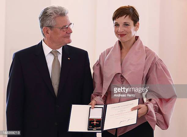 Actress Meret Becker receives the Federal Cross of Merit from German President Joachim Gauck at Bellevue Palace on October 4 2012 in Berlin Germany