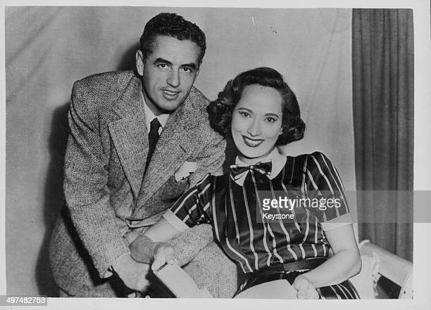 Actress Merle Oberon and her husband cinematographer Lucien Ballard posing together for a portrait circa 1945