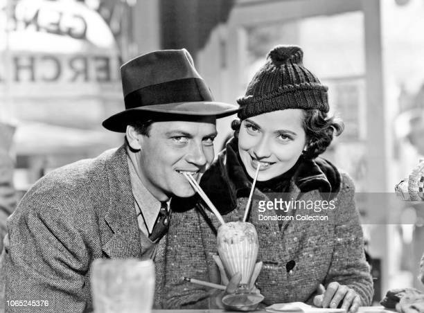 Actress Merle Oberon and Joel McCrea in a scene from the movie These Three