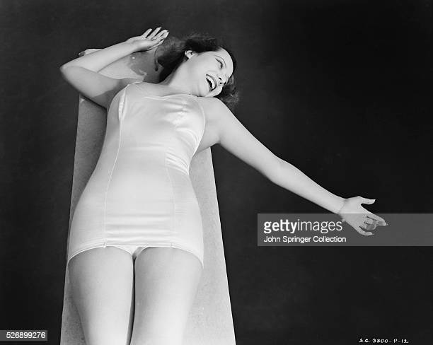 Actress Merle Oberon Lying on Diving Board