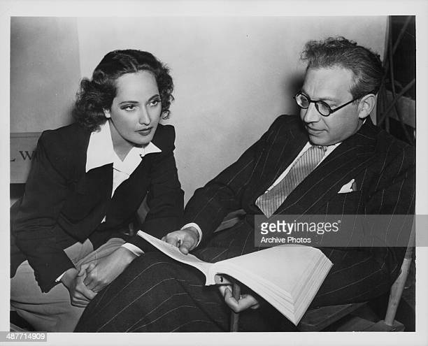 Actress Merle Oberon with her husband film producer Alexander Korda reading a script together circa 19391945