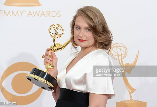 Actress Merritt Wever winner of the Best Supporting Actress In A Comedy Series Award for Nurse Jackie poses in the press room during the 65th Annual...