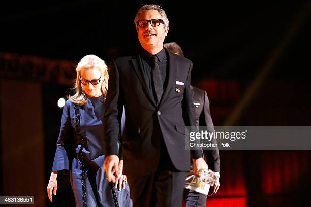 Actress Meryl Streep and director Alfonso Cuaron onstage during the 19th Annual Critics' Choice Movie Awards at Barker Hangar on January 16 2014 in...