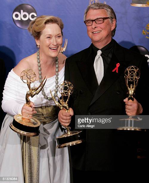 Actress Meryl Streep and director Mike Nichols winners for Outstanding Miniseries for HBO's Angels in America pose backstage during the 56th Annual...