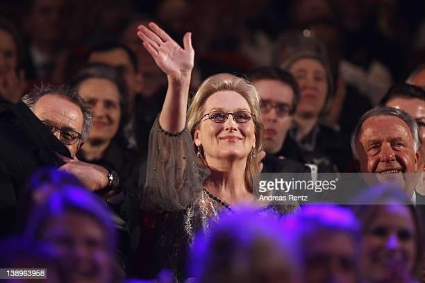 Actress Meryl Streep waves from the audience ahead of her receiving the Golden Honorary Bear award for Lifetime Achievement prior to The Iron Lady...