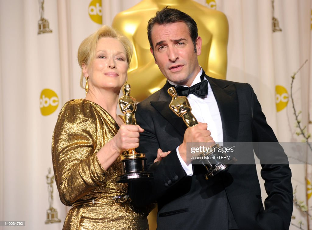 Actress Meryl Streep (L), winner of the Best Actress Award for 'The Iron Lady,' and actor Jean Dujardin, winner of the Best Actor Award for 'The Artist,' pose in the press room at the 84th Annual Academy Awards held at the Hollywood & Highland Center on February 26, 2012 in Hollywood, California.