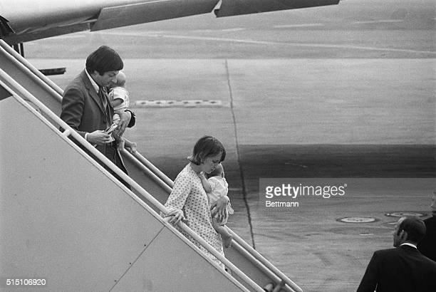 Actress Mia Farrow and conductor Andre Previn carry their twins Matthew Phineas and Sacha Villiers as they leave their plane here following a flight...