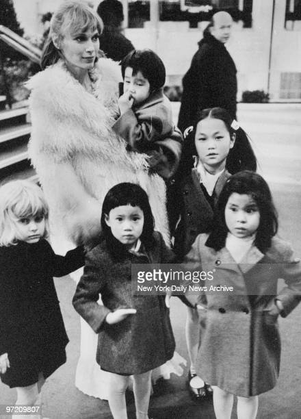 Actress Mia Farrow and five of her seven children enjoy winter sunshine Mia holds Misha and next to Mia stands SoonYi Previn In front are Fletcher...