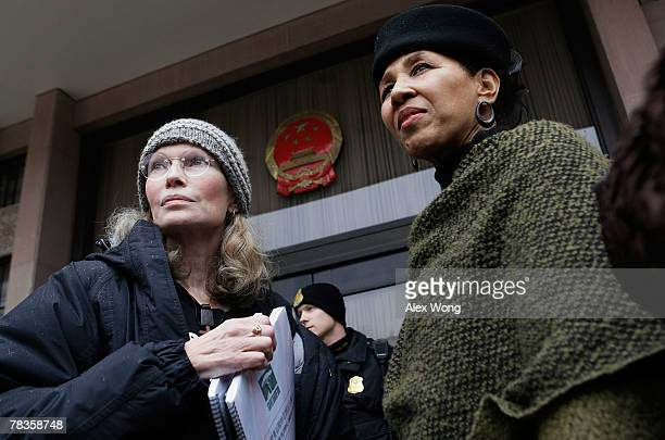 Actress Mia Farrow and My Sister's Keeper co-founder Gloria White-Hammond wait to deliver media clips of a torch relay campaign, which started in...