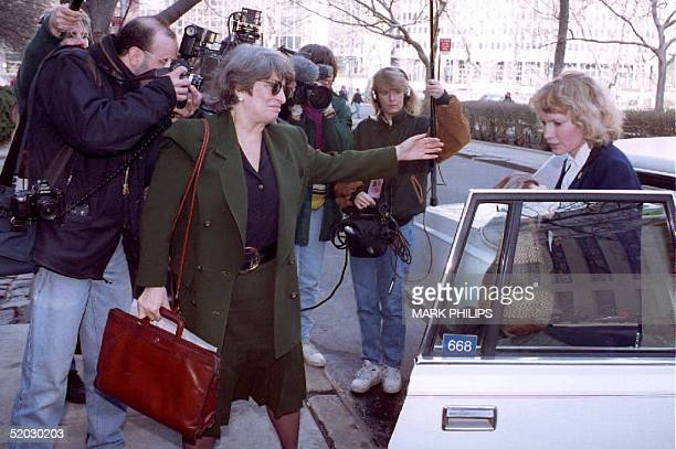 Actress Mia Farrow is escorted past photographers 26 March 1993 by her attorney Eleanor Alter as she heads into court for another day of testimony in...