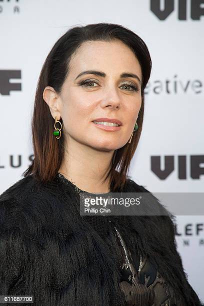 Actress Mia Kirshner arrives on the red carpet for her film 'Milton's Secret' at the Centre for the Performing Arts during the 35th Vancouver...