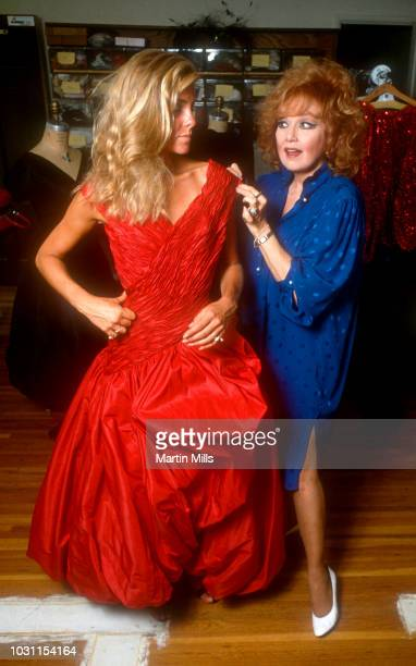 Actress Mia Kovacs and her mother American comedienne actress singer and businesswoman Edie Adams tries on a dress from the clothing company Bonham...