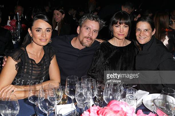 Actress Mia Maestro donor Balthazar Getty designer Rosetta Millington and donor Aileen Getty attend amfAR's Inspiration Gala Los Angeles at Milk...