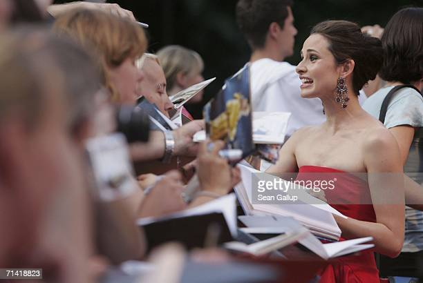 """Actress Mia Maestro signs autographs as she arrives for the German premiere of """"Poseidon"""" July 11, 2006 at the Berlinale Palast in Berlin, Germany."""