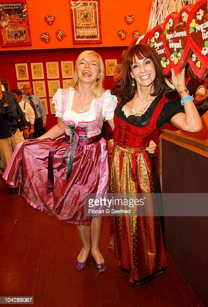 Actress Michaela Merten and singer Anna Maria Kaufmann attend the 'Sixt Damenwiesn' during the Oktoberfest 2010 at Hippodrom at Theresienwiese on...