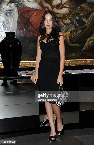 Actress Michela Quattrociocche poses in the VIP room at the Dolce Gabbana Spring/Summer 2012 fashion show as part Milan Womenswear Fashion Week on...