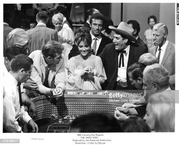 Actress Michele Carey and actor Anthony Franciosa at a craps table in a scene of the 20th Century Fox movie The Sweet Ride circa 1968