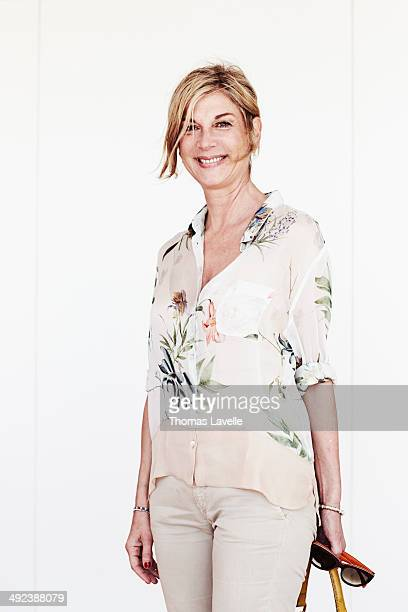 Actress Michele Laroque is photographed for Self Assignment on May 18 2014 in Cannes France