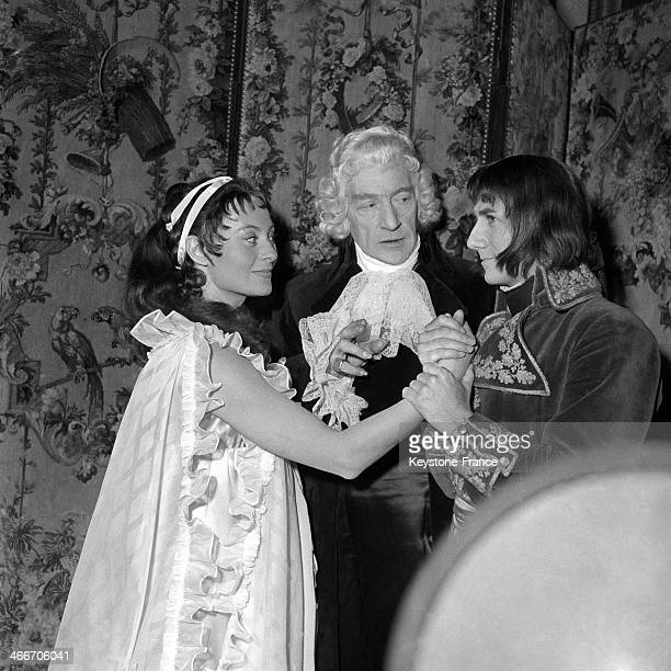 Actress Michele Morgan and actor Daniel Gelin with director Sacha Guitry on set of movie Napoleon in 1954 in France