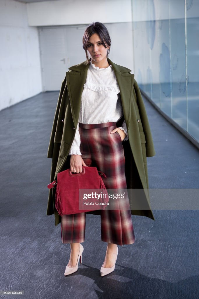 Actress Michelle Calvo wears Ursula Mascaro shoes, Angel Schlesser trousers, shirt and jacket and Maje handbag at Ifema during Mercedes Benz Fashion Week Madrid Autumn / Winter 2017 on February 20, 2017 in Madrid, Spain.