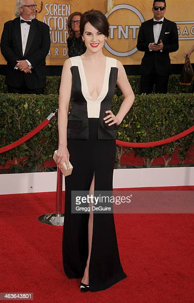 Actress Michelle Dockery arrives at the 20th Annual Screen Actors Guild Awards at The Shrine Auditorium on January 18 2014 in Los Angeles California