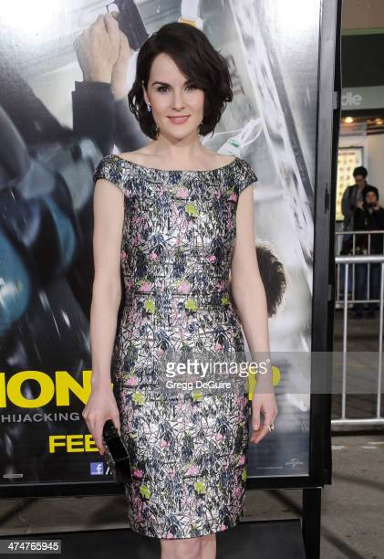 Actress Michelle Dockery arrives at the Los Angeles premiere of 'NonStop' at Regency Village Theatre on February 24 2014 in Westwood California