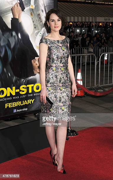 Actress Michelle Dockery arrives at the 'NonStop' at Regency Village Theatre on February 24 2014 in Westwood California