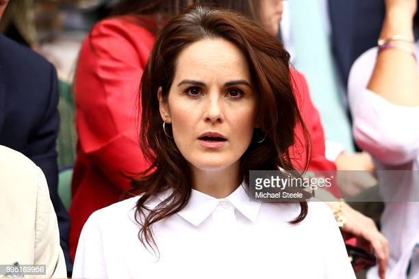 Actress Michelle Dockery attends day eight of the Wimbledon Lawn Tennis Championships at All England Lawn Tennis and Croquet Club on July 10 2018 in...