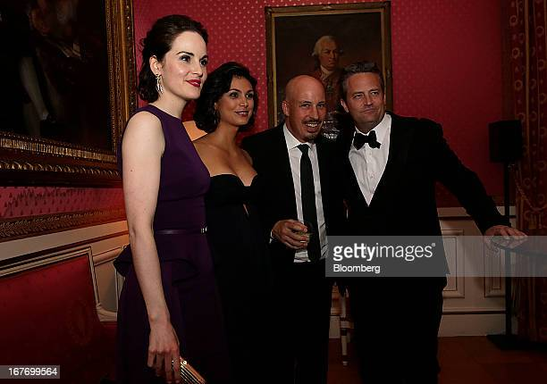 Actress Michelle Dockery from left actress Morena Baccarin a guest and actor Matthew Perry attend the Bloomberg Vanity Fair White House...