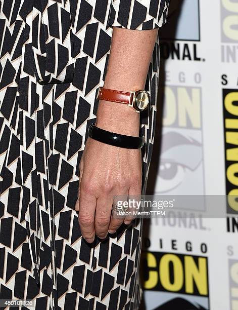 Actress Michelle Gomez jewelry detail attends the BBC America Doctor Who photo call during ComicCon International 2015 at the Hilton Bayfront on July...