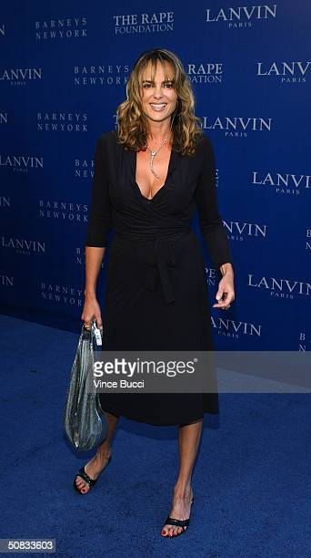 Actress Michelle Johnson attends the Fall 2004 Lanvin Fashion Show benefiting the Rape Foundation on May 12 2004 at the Barneys New York store in...