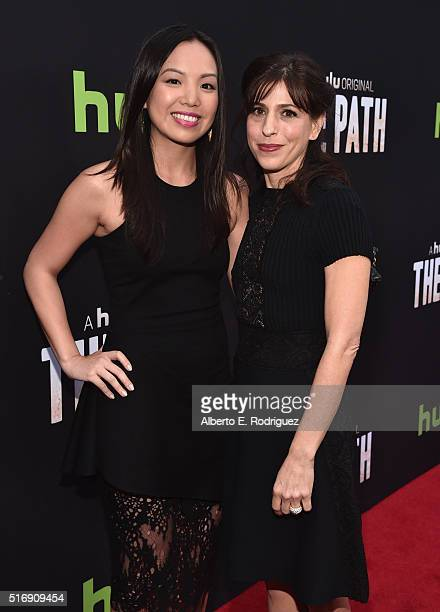 Actress Michelle Lee and Jessica Goldberg attend the premiere of Hulu's 'The Path' at ArcLight Hollywood on March 21 2016 in Hollywood California