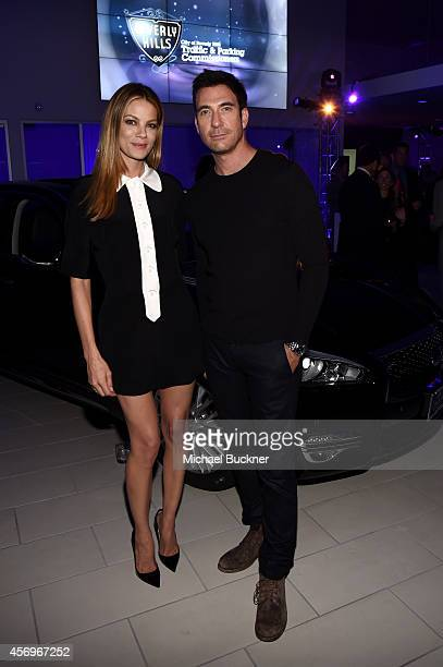 Actress Michelle Monaghan and actor Dylan McDermott attend the grand opening of Infiniti of Beverly Hills on October 9 2014 in Beverly Hills...