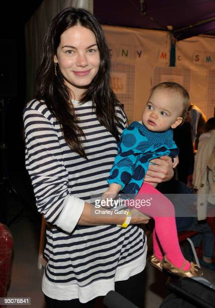 Actress Michelle Monaghan and daughter Willow attend PS Arts Express Yourself 2009 at Barker Hangar at the Santa Monica Airport on November 15 2009...