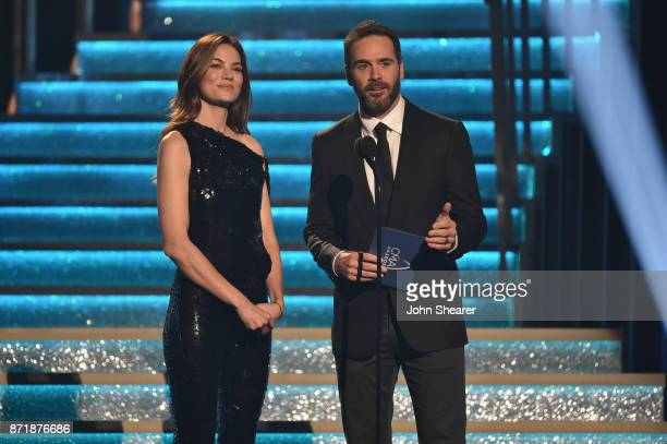 Actress Michelle Monaghan and Nascar driver Jimmie Johnson speak onstage during the 51st annual CMA Awards at the Bridgestone Arena on November 8...