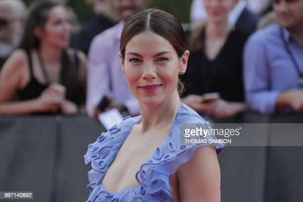 US actress Michelle Monaghan poses on the red carpet as she arrives to attend the world premiere of Mission Impossible Fallout on July 12 2018 at the...