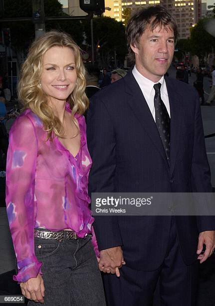 """Actress Michelle Pfeiffer and husband David E. Kelley attend the premiere of """"What Lies Beneath"""" July 18, 2000 at the Mann's Village Theater in..."""