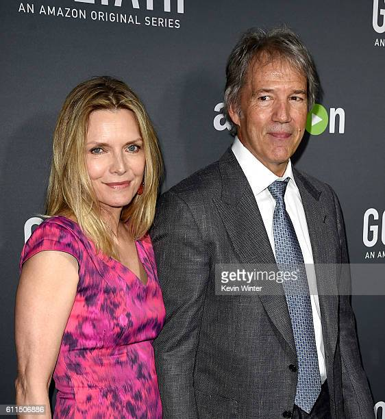 """Actress Michelle Pfeiffer and husband, writer/executive producer David E. Kelley arrive at the premiere screening of Amazon's """"Goliath"""" at The London..."""
