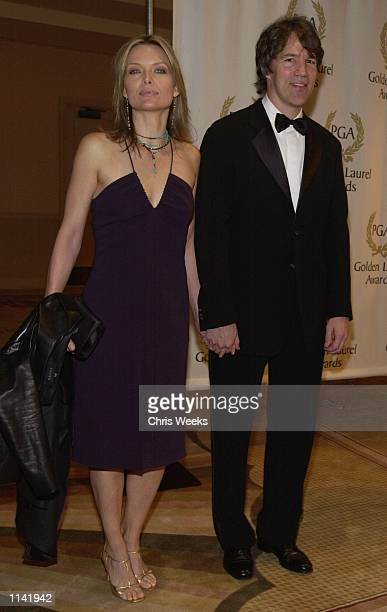 Actress Michelle Pfeiffer and husband/producer David E Kelley recipient of the David Susskind Lifetime Achievement Award in Television arrive at the...