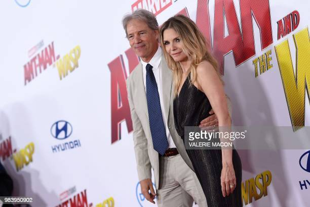 US actress Michelle Pfeiffer and producer David E Kelley attend the World Premiere of Marvel Studios' 'AntMan and The Wasp' at the El Capitan Theater...