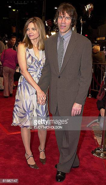 US actress Michelle Pfeiffer arrives at the premiere of the new film Cast Away with her husband David E Kelley in Los Angeles 07 December 2000 The...