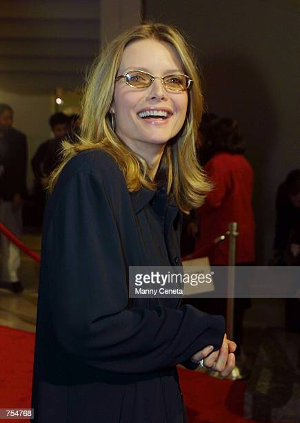 Actress Michelle Pfeiffer arrives at the Special Olympics benefit premiere of movie i am sam January 22 2002 in Washington DC Pfeiffer portrayed Rita...