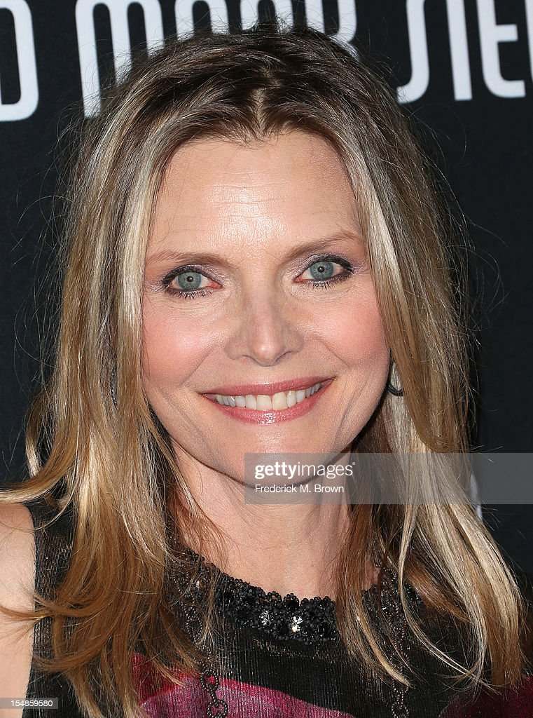 Actress Michelle Pfeiffer attends Elyse Walker Presents The Eighth Annual Pink Party Hosted By Michelle Pfeiffer To Benefit Cedars-Sinai Women's Cancer Program at Barkar Hangar Santa Monica Airport on October 27, 2012 in Santa Monica, California.