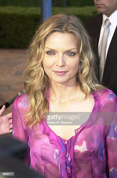 """Actress Michelle Pfeiffer attends the premiere of """"What Lies Beneath"""" July 18, 2000 at the Mann's Village Theater in Westwood, CA."""