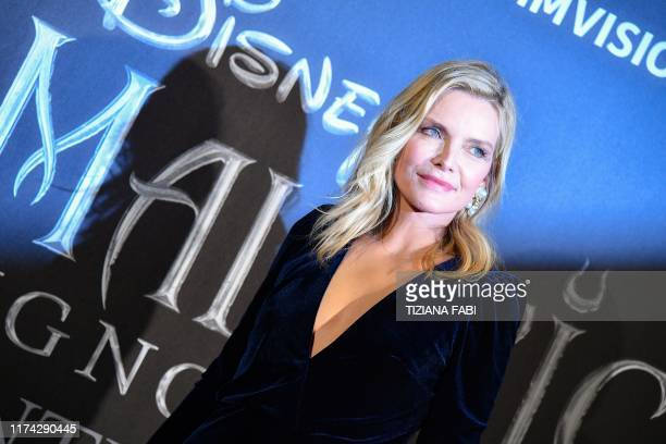 """Actress Michelle Pfeiffer poses during the European premiere of Disney's dark fantasy adventure film """"Maleficent : Mistress of Evil"""" on October 7,..."""
