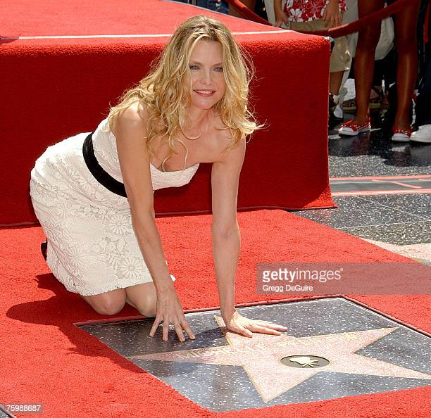 Actress Michelle Pfeiffer poses for the media at her Hollywood Star Walk of Fame ceremony on Hollywood Blvd on July 6 2007 in Hollywood California