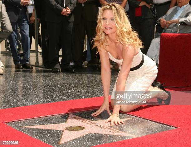 Actress Michelle Pfeiffer poses for the media at her Hollywood Walk of Fame star ceremony on Hollywood Blvd July 6 2007 in Hollywood California